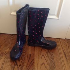 JCrew navy and pink polka dot rain boots - size 10 Never worn JCrew rain boots. I have stored these in a plastic tote since I bought them and they are in like new condition. They are rubber wellies in navy with pink polka dots. The jcrew label is in the boot. The picture above is dark but you can still see the label. J. Crew Shoes Winter & Rain Boots