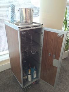 Ex-airline (Pacific Southwest Airlines) Galley Cart - makes an excellent home bar / drinks cabinet. Rare wood-effect panels.