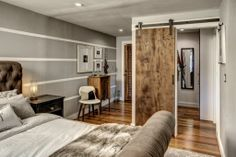 Though small this master bedroom feels large through the use of paint and appropriate sized furniture.  A barn door helps make the most of the space.
