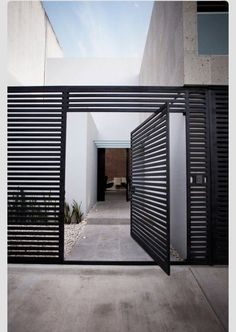 Awesome Volume House of Cereza 20 by Warm Architects in Cancun: Beautiful Cereza Home Design Exterior With Modern Welcome Gate Used Black Door Design Ideas And Concrete Flooring Style ~ SFXit Design Architecture Inspiration The Doors, Front Door Design, Entrance Design, House Entrance, Gate House, Modern Entrance Door, Garden Entrance, Main Entrance, Design Entrée