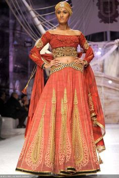 A model showcases a creation by designer JJ Valaya on Day 1 of India Bridal Fashion Week, held in New Delhi, on July 23, 2013.