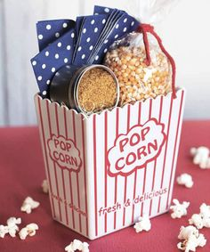 Dress up popcorn kernels with a reusable concessions-stand container, a stash of cheery polka-dot napkins, and a supersimple coconut-curry topping. (Similar: plastic popcorn box, $16.95; ht-accessories.com; paper napkins, $3.49 for 24; stumpsparty.com; Masterpiece Studios tins, $13.90 for 12; amazon.com)