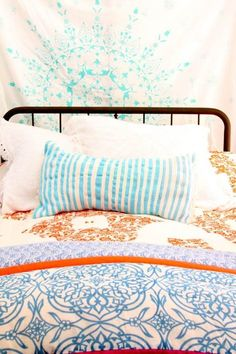 Love the mixture of colors and patterns! Feels happy to me!  Alisha's Bright White Guest Cottage