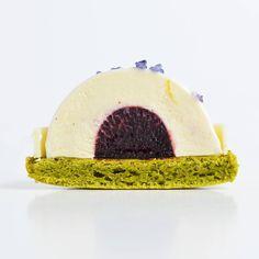 «It's what's on the inside that counts. Jasmine green tea macaron, honey orange mousse, elderberry coulis @langhamchicago #pastry #chefstalk…»