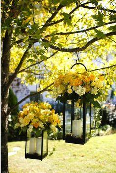 yellow floral and lantern wedding decor