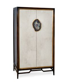 Mark McDowell designed his Anzu Cabinet for John-Richard. The double doors are finished to look like stone and the natural agate hardware is edged in gold leaf. The scale of this armoire is modern and is multi-functional, perfect for a living room or bedroom... or any room! #hpmkt #hpmktss #cryptonhome