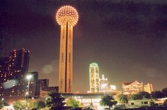 Reunion Tower at night downtown Dallas.  Dine with Chef Wolfgang Puck at the top