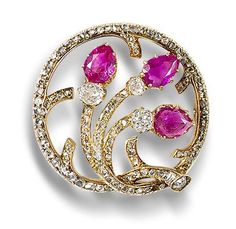 A ruby and diamond brooch, by Fabergé, circa 1900. Of openwork annular form, the old brilliant and rose-cut diamond wreath issuing pear-shaped ruby buds, mounted in yellow gold, workmaster mark AH for either August or Albert Holmström.