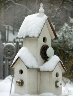 Buy cheap Dollar store bird houses and glue them together, add old knobs.  These are easy to build with scrap wood too! by Mudgey