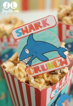 """Yesterday, my youngest son happily told me that the Discovery Channel's annual """"Shark Week"""" was starting. I created these shark themed boxes using Lettering Delights to celebrate shark w. Peanut Butter Popcorn, Chocolate Peanut Butter, White Chocolate, Recipes Appetizers And Snacks, Popcorn Recipes, Holiday Desserts, Holiday Treats, Silhouette Cameo, Silhouette Projects"""