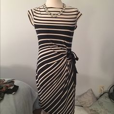Navy striped dress Navy and cream striped short sleeve dress. Has ties on the side of the dress. 95% polyester 5% spandex. Stretchy material Just Taylor Dresses Midi