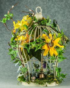 cute garden house in a birdcage