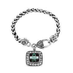 Show your support and help spread awareness every day with this fabulous classic braided bracelet! Our sparkling classic bracelet features a 7 1/2 inch braided bracelet complimented with a decorative lobster claw clasp topped with a .925 sterling silver finish! The showcased square charm is also coated with a sterling silver finish and is accented with 2.0 carats of pave set cubic zirconia stones. Lookout for the matching necklace, earrings, and memory charm! This product is proudly made in…