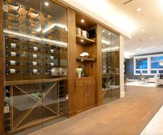 This custom Timeless Contemporary wine cellar design uses our exclusive extendable pegs which allows the collector to showcase their wine collection horizontally and show off the stunning labels. Mounted on Solid Walnut wood with lacquer finishes. Wine Cellar Design, Wine Collection, Wine Cellars, Walnut Wood, Contemporary, Modern, Liquor Cabinet, Storage, Furniture