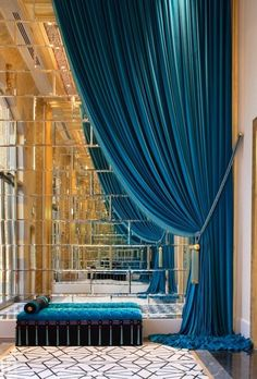 Stunning teal drapery + mirrored wall. for some crazy reason or another I really like this.
