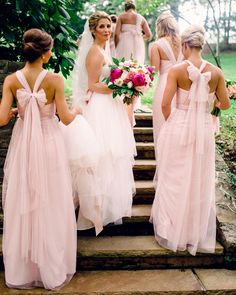 Jenny Yoo Bridesmaids, the convertible Annabelle Dress provides endless variations of a bridal party dress with detachable straps to create multiple different looks. This Soft Tulle Bridesmaids Dress in a shade of Pink is perfect for a Summer or Spring Wedding // Photo by Britta Marie Photography