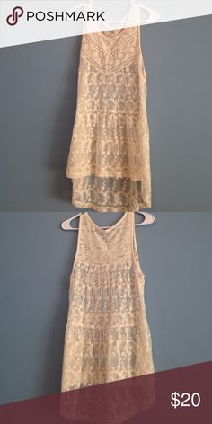 Lacey tunic Off white Lacey tunic. Sheer lightly worn this vintage like top is flowing and light Tops Tunics