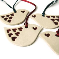 laser cut and engraved bird ornaments.