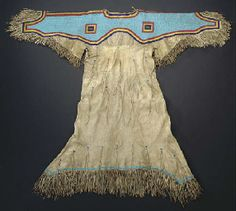 A SIOUX BEADED AND FRINGED HIDE DRESS