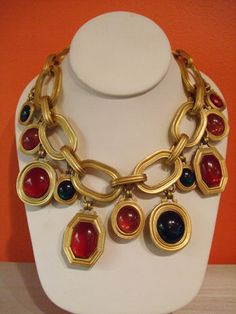 An early 80s, limited edition necklace from Yves St. Laurent with round, oval and octagonal charms; $ 850.00