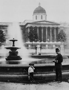 A policeman questions a young boy who probably intended to fish in the fountain on Trafalgar Square, London, England 1892 Victorian London, Vintage London, Old London, Victorian Era, Edwardian Era, Douglas Macarthur, Trafalgar Square, London History, British History