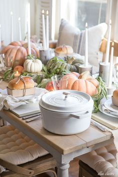 The secret to this charming fall tablescape? Set the table first, then fill in the open space with pumpkins and rustic DIY candlesticks. Get the tutorial at Ella Claire.