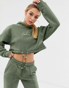 Buy The Couture Club cropped motif drawstring hoody in khaki at ASOS. With free delivery and return options (Ts&Cs apply), online shopping has never been so easy. Get the latest trends with ASOS now. Safari, Asos, Couture, Latest Trends, Rain Jacket, Windbreaker, Velvet, Zip, Hoodies