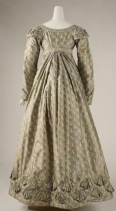 """c.1820 Dress, British; silk  """"There are indications that the dress was remade from an earlier costume (late 18th century). The implicit luxury of the chiné silk and the small repeat in the neo-classical taste allowed the textile's persistence into new dress forms."""" (view 4)"""