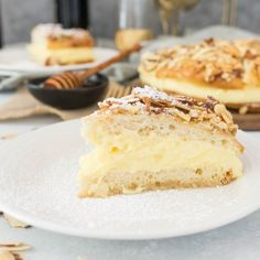 A delicious treat for Oktoberfest, this German dessert cake is flavored with honey and filled with creamy pastry cream.  Prost!