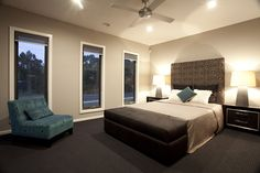 The couch adds a relaxed feel to this bedroom.