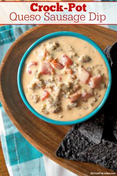 Crock-Pot Queso Sausage Dip - Grab your favorite chips crackers or fresh veggies and dip on into this amazing Crock-Pot Queso Sausage Dip. Your party guests will love this recipe! Sausage Dip, How To Cook Sausage, Slow Cooker Recipes, Crockpot Recipes, Cooking Recipes, Dip Recipes, Appetizer Recipes, Appetizers, Cheesy Recipes