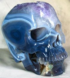 creepy but gorgeous crystal geode carved into a skull  would loveit on my desk!