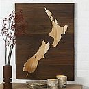 Bespoke Wooden Map by Wooden Worlds.map in bronze or copper on dark wood