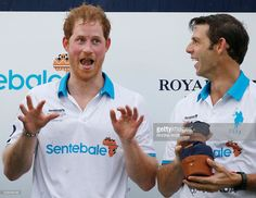 Britain's Prince Harry (L) and Royal Salute ambassador Malcolm Borwick (R) laugh following the Sentebale Royal Salute Polo Cup 2016 at the Valiente Polo Farm in Wellington, Florida on May 4, 2016. / AFP / RHONA