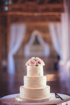 White three tier cake at summer barn wedding in Maryland