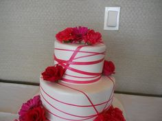 Supreme Kakes - Houston Cakes - Hot pink and white wedding cake with fresh flowers