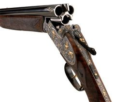 Engraved triple barrel shotgun.