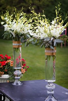 White Dendrobium orchid centerpieces. By Heather Petrus Wedding Flowers