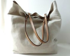 Linen tote bag with leather handles.