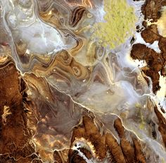 The landscape of the Tanezrouft Basin, one of the most desolate parts of the Sahara desert, in south-central Algeria. The region is known as 'land of terror' because of its lack of water and vegetation, JAXA/ESA