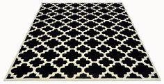 A fully Bespoke hand tufted wool rug in black and white. Created using the customers own design. #CustomRugRoom