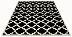 A fully Bespoke hand tufted wool rug in black and white. Created using the customers own design. #CustomRugRoom