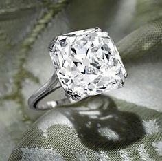 The Rajah Diamond – The old-mine brilliant-cut diamond, weighing approximately 26.14 carats, set in a platinum mount, ring size 7¼ Accompani...