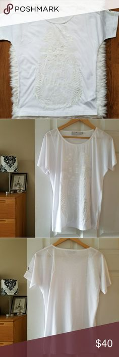 """adidas stella mccartney embroidered top Measurements lying flat:  Bust: 21"""" Length:26"""" 88% polyester, 12% cotton  ***Tag says 36 so I listed as Large but please check above measurements prior to purchase***  -Smoke-free home  -Reasonable offers welcome, but prices are firm on items under $10.  -No trades, please.  -All measurements are approximate.  💕💕💕Thank you for shopping my closet, it means a lot to me!💕💕💕 Adidas by Stella McCartney Tops Tees - Short Sleeve"""