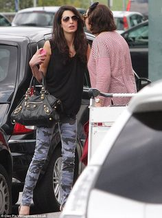 George Clooney's fiance Amal Alamuddin was spotted arriving at Milan Airport in camouflage skinny jeans http://dailym.ai/1mgpou6
