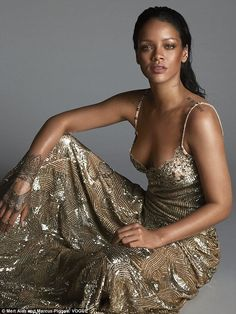 Golden girl: Rihanna posed for the April issue of Vogue as she insisted she is single
