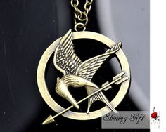 Hunger Games Logo Pendant NecklaceInspired by Shininggift on Etsy, $2.99
