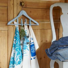 Transform hangers into peg racks and baking trays into memo boards with Country Homes & Interiors' thrifty upcycling ideas.