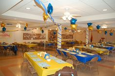 Blue & Gold banquet....how 'bout just blue/gold colors and simple balloons for centerpieces? Way less Den time spent on elaborate centerpieces that end up in the trash eventually.