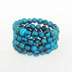 Acai Bead Multi Strand Bracelet ($24) ❤ liked on Polyvore featuring jewelry, bracelets, beading jewelry, turquoise beaded jewelry, beaded jewelry, bead jewellery and green turquoise jewelry